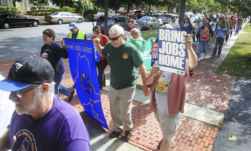 "Attendees at the Southern Maine Labor Council's annual breakfast conclude the event, held Monday at the Maine Irish Heritage Center, with a march along State Street to Longfellow Square for a poetry reading. As they marched, they chanted, ""We are the 99 percent."""