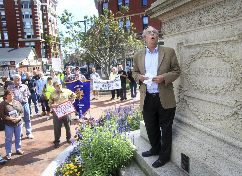 Harlan Baker reads a poem for union members at Longfellow Square after the labor breakfast. Some said they attended because they hoped the rally would offer solutions to what they viewed as limited opportunities afforded to the middle class.
