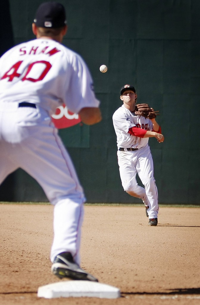 Zach Gentile, Sea Dogs second baseman, throws to Travis Shaw for an out in the top of the seventh inning Monday at Hadlock Field.