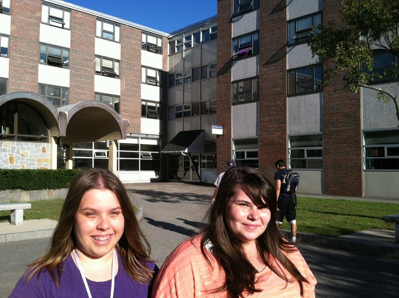 Marnie Lantagne, left, of Arundel, and Danielle Dalton, of Saco, stand near their dormitory, Upton-Hastings Hall, at USM in Gorham, which was evacuated during a fire Monday.