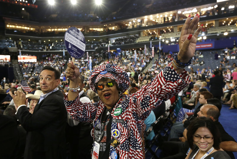 Colorado delegate Julia Hicks cheers at the Democratic National Convention in Charlotte, N.C., on Tuesday. The Democratic platform backs same-sex marriage and abortion rights.