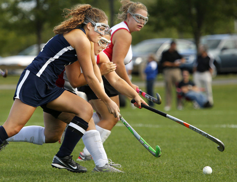 Leanne Reichert of Portland, foreground, and Kailey Hannigan of South Portland contend for the field hockey ball Wednesday during their Southern Maine Activities Association game. South Portland, playing at home, came away with a 2-0 victory.