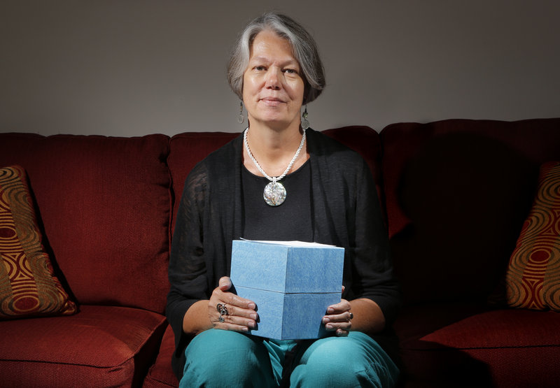 Karin Anderson of Portland holds a box containing the cremated remains of her husband, Steve Fisk, a Bowdoin College math professor who died in early 2010. She and her husband, when he was in hospice care, talked about how her to dispose of his body.