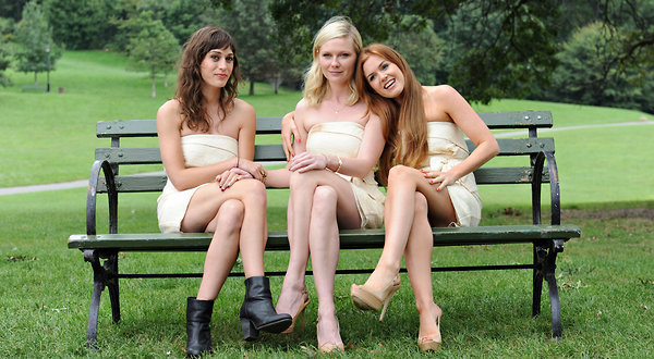 "Lizzy Caplan, left, Kirsten Dunst and Isla Fisher in ""Bachelorette."""