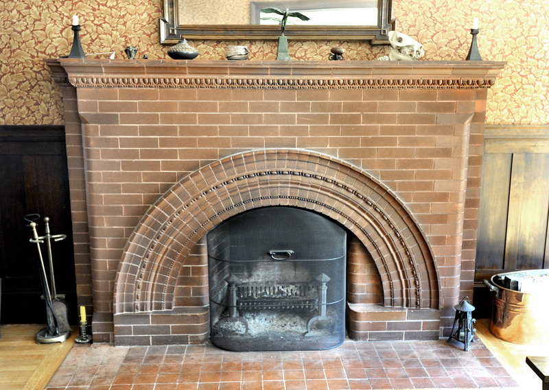 "The fireplace in the living room with its ""egg and dart"" detailing."