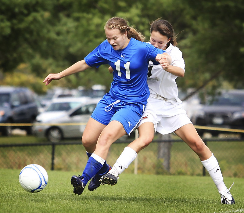 Katie Labbay of Mt. Ararat attempts to control the ball and hold off Rachel Moroney of Brunswick during their Eastern Class A girls' soccer game Saturday. Brunswick improved its record to 3-0 with a 4-0 victory at home.