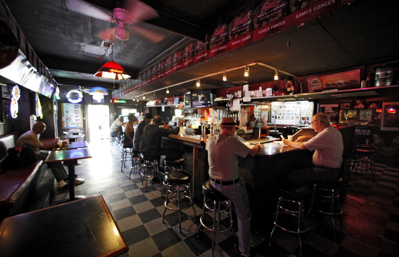 Patrons frequent the King Eddy Saloon, one of the oldest and most colorful dive bars in Los Angeles, on Friday. For a century, the King Eddy has survived everything the Skid Row neighborhood could throw at it, including Prohibition, but it will close sometime in the coming weeks for extensive renovations.