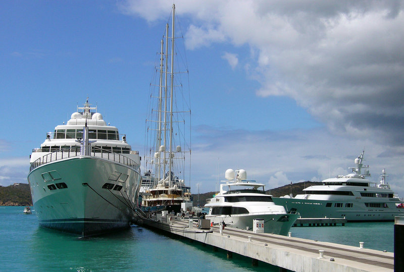 The Rising Sun, a five-story super-yacht, sits at anchor next to a sailboat and smaller yachts at the Yacht Haven Grande harbor in St. Thomas, U.S. Virgin Islands in 2007. The yacht is expected to berth at the Maine State Pier later this month.