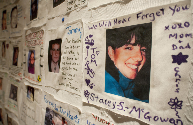 Photos of victims of the terrorist attacks of Sept. 11, 2001, and messages of loved ones, are displayed Monday in New York. The images and recorded voices of those who died will be part of the future 9/11 Memorial Museum, along with artifacts like a staircase used to escape.