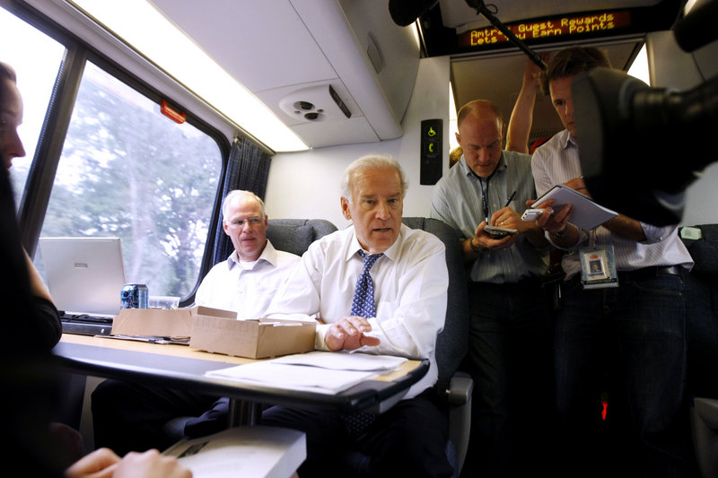 Then-Democratic vice-presidential candidate Joe Biden mingles with passengers aboard the Amtrak Acela train from Washington to Wilmington, Del. A train supporter, he has traveled the route more than 7,900 times, he said.