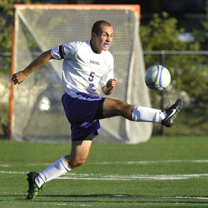 Nathan Finberg of Deering reaches out to control a long pass during Monday's SMAA boys' soccer game against Gorham at Deering's Memorial Field. Gorham is 3-0-1 after its 2-1 win.