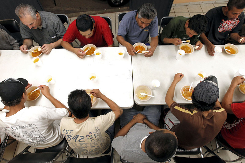 Dozens of men, many of them Mexican citizens, eat dinner at an immigrant shelter in Nogales, Mexico, last month. Some of them would decide to try to illegally cross the border into the United States. The United States no longer flies them back if they're caught.
