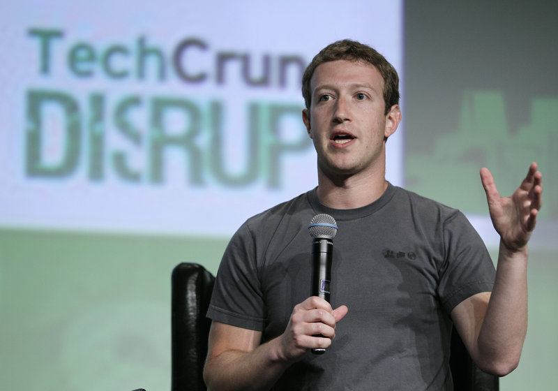"Facebook's Mark Zuckerberg speaks during a ""fireside chat"" at a conference organized by technology blog TechCrunch in San Francisco on Tuesday – his first interview since the company's rocky IPO in May."