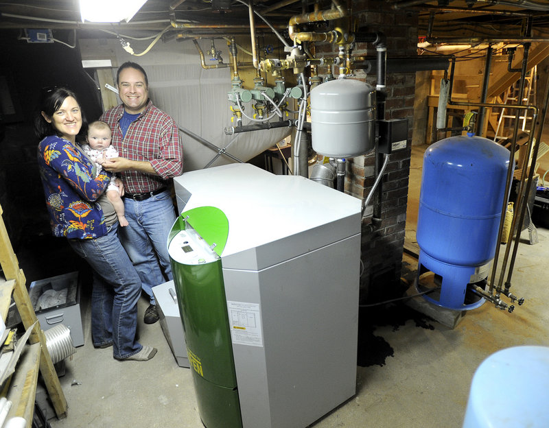 Molly and Chris Just with their six-month-old son Ben just installed this wood-pellet boiler (foreground), to replace their old oil-fired boiler. Maine's consumption of oil is steadily declining and has reached levels not seen since 1984.