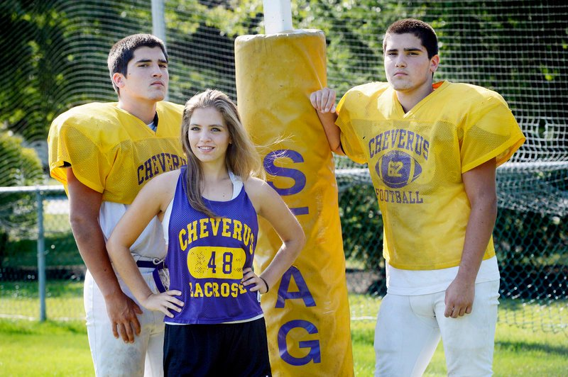 Jim Peabody-Harrington, left, and his brother, Dan, have made an impression at Cheverus, both playing on a line that has sprung holes for a team seeking a third consecutive state title. Their sister, Laura, completes the triplets, and plays field hockey and lacrosse.
