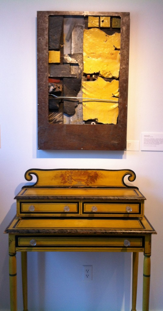 """Yellow Mesa"" by New Hampshire ceramic artist Don Williams hangs above a yellow painted dresser owned by Hap Moore Antiques Auctions of York in ""Accord VIII"" at the George Marshall Store Gallery."