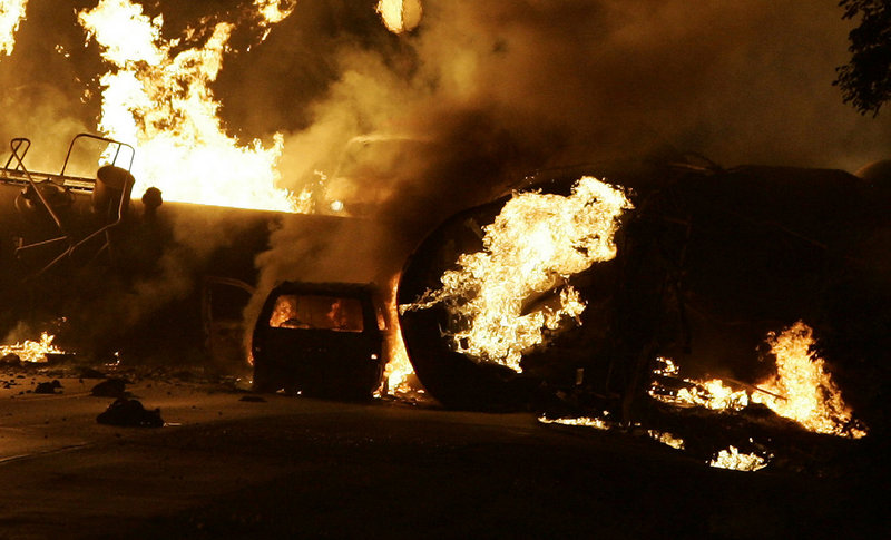 A vehicle burns near a train derailment near Rockford, Ill., in 2009. Residents were forced to evacuate after the fiery freight train derailment northwest of Chicago.