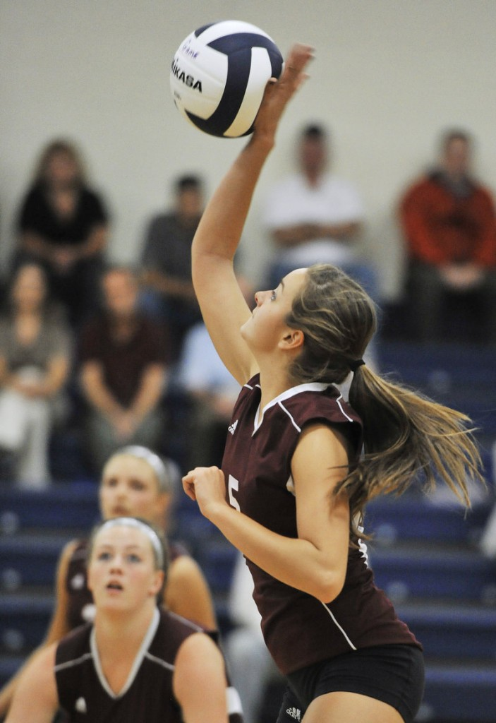 Quincy Shaw of Gorham goes for a kill shot Wednesday night during the showdown match against Yarmouth in volleyball. Gorham, on the road, won in straight games in a match between teams that entered with undefeated records.
