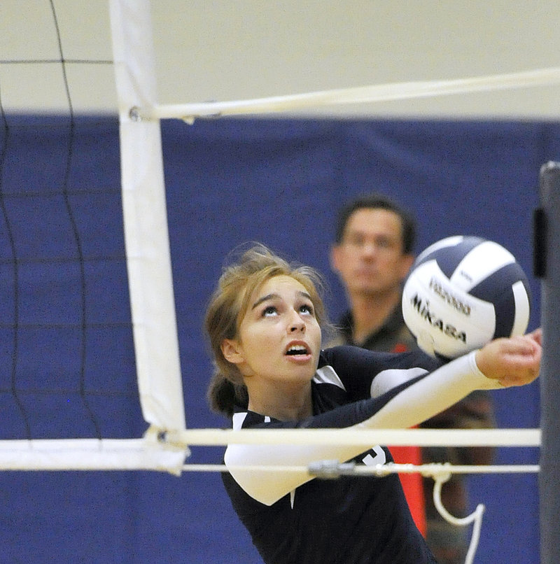 Abby Latham of Yarmouth retains her concentration while saving a ball from going out of bounds.