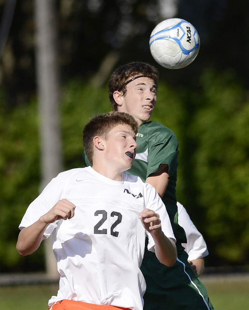 Matt Hawkins of North Yarmouth Academy goes up for a header as Jack Cutler of Waynflete challenges from behind Thursday during Waynflete's 5-0 victory.