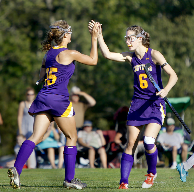 Elyse Caiazzo, left, of Cheverus high-fives teammate Meredith Willard after scoring the second goal of the first half Thursday, helping the Stags reach 6-0 with a 3-1 victory against previously undefeated Massabesic.