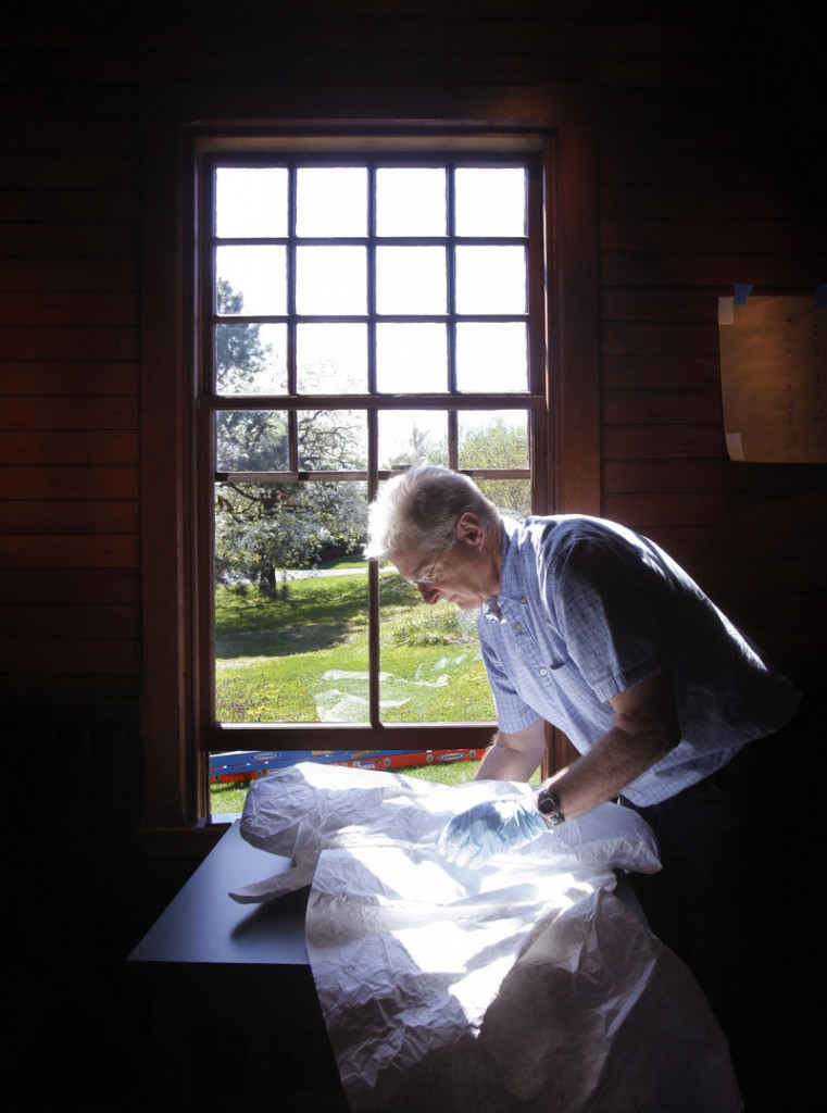 Greg Welch, chief preparator with the Portland Museum of Art, unwraps a piece to be exhibited at the Scarborough site, where Homer lived for parts of the year from 1883 until his death in 1910 at age 74.