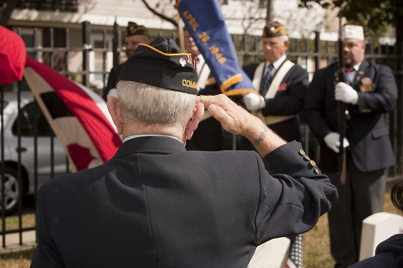 A color guard honors Richard Hill, an African-American veteran of the War of 1812, whose grave was rediscovered at Eastern Cemetery in Portland, on Saturday.