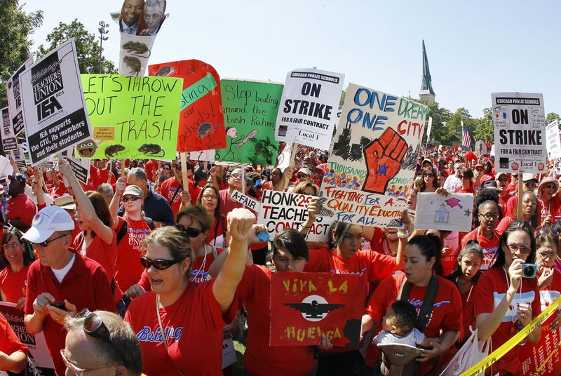 """Striking Chicago teachers rally at Union Park on Saturday. Union President Karen Lewis said there is a """"framework"""" for an end to the walkout, but the teachers are still on strike."""
