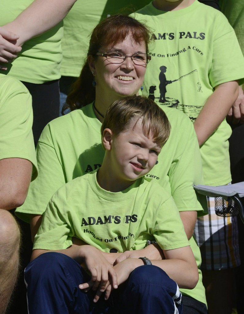 Amy Jacobson of Cumberland poses for photographs with her son Adam, 7, before the walk at Payson Park in Portland on Sunday. Adam has type 1 diabetes and had a large group – Adam's Pals – walking on his behalf.