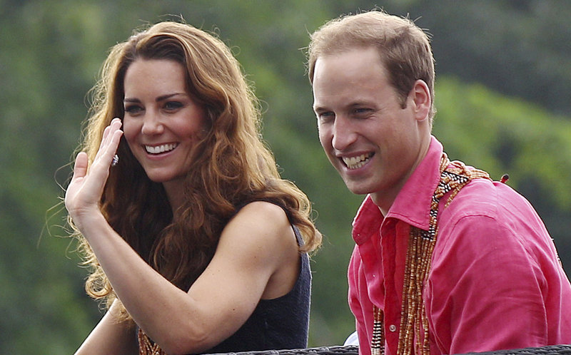 Prince William and his wife, Kate, smile while watching a shark ceremony in the Solomon Islands on Monday. They're not smiling, though, over published photos of a certain topless duchess.
