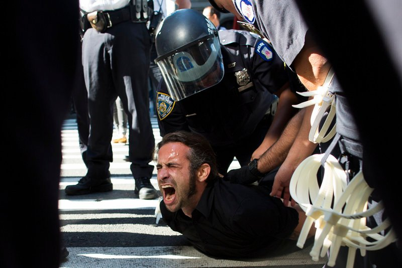 Occupy Wall Street protester Chris Philips screams as he is arrested near Zuccotti Park in New York City on Monday.