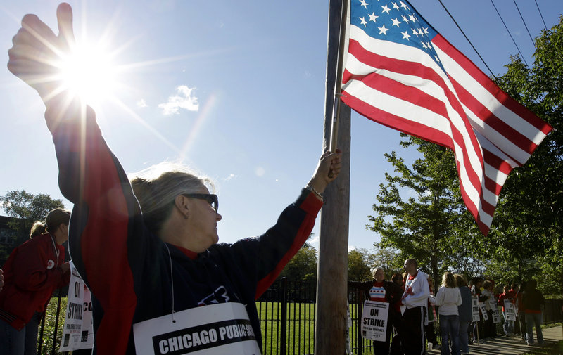 As the Chicago Teachers Union delegates met Tuesday to vote on ending their strike, others continued picketing outside an elementary school. They voted to return to the classroom.