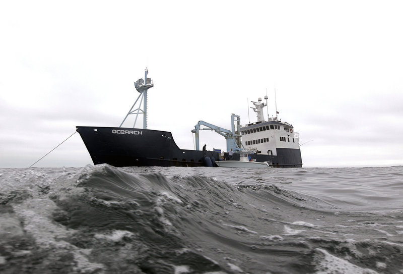 In this Sept. 7, 2012, photo, the research vessel Ocearch has set her anchor as the crew begins their search for great white sharks on the Atlantic Ocean, spending two to three weeks tagging sharks and collecting blood and tissue samples off the coast of Chatham, Mass. The Ocearch team baits the fish and leads them onto a lift, tagging and taking blood, tissue and semen samples up close from the world's most feared predator. The real-time satellite tag tracks the shark each time its dorsal fin breaks the surface, plotting its location on a map. (AP Photo/Stephan Savoia)