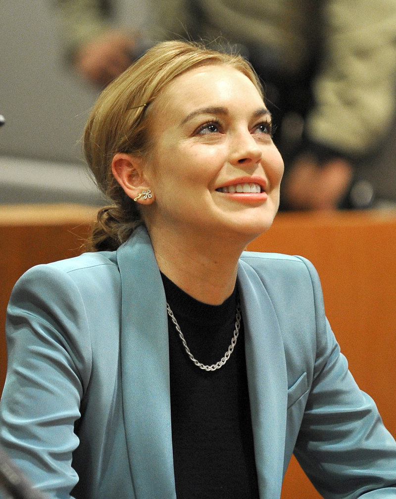 Lindsay Lohan is charged with leaving the scene of an accident in New York.