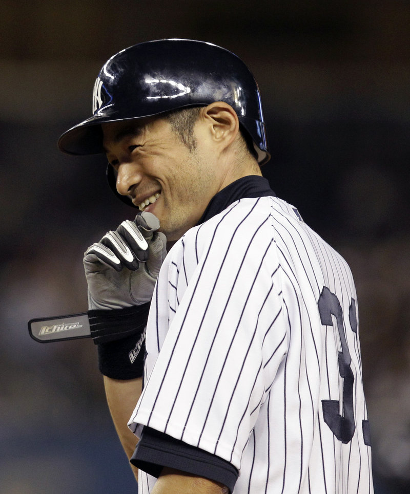 Ichiro Suzuki is all smiles after driving in the winning run of Wednesday's second game. The Yanks swept the Blue Jays, 4-2 and 2-1. Suzuki was 7 for 8 in the sweep.