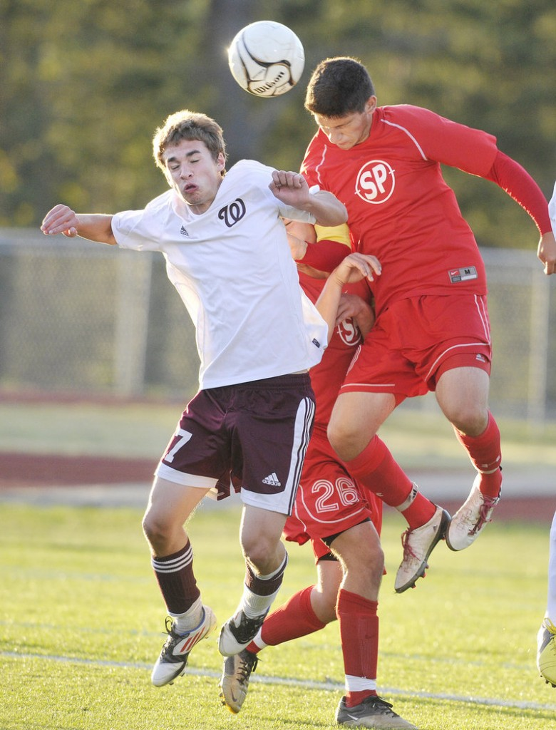 Marc Reynolds of Windham, left, competes with Adam Helmke of South Portland for the ball Thursday night during Windham's 2-1 victory in an SMAA boys' soccer match at South Portland.