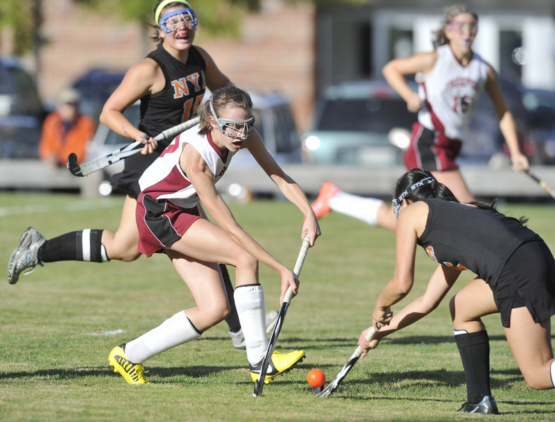 Olivia Bubar of Freeport, left, attempts to push the ball past Jen Brown of North Yarmouth Academy during NYA's 5-1 field hockey victory Thursday.