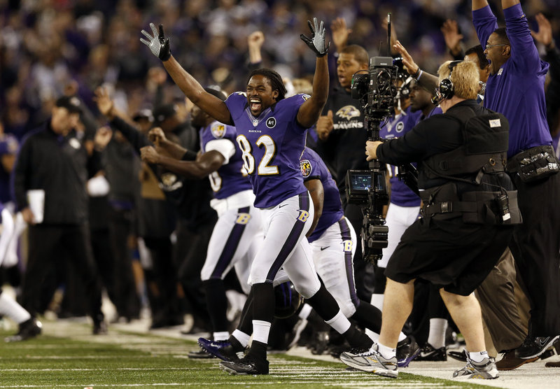Torrey Smith, who caught two touchdown passes for the Ravens, celebrates after Justin Tucker kicked a 27-yard field goal as time expired to give Baltimore a 31-30 win Sunday night over the Patriots.