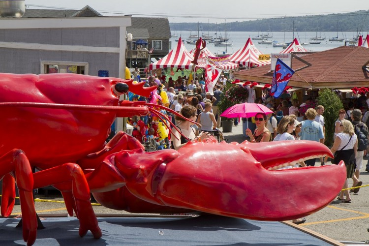 In this August 2011 file photo, the crowd funnels into Rockland's Annual Lobster Festival, past a giant crustacean. Two cruise lines have agreed to buys thousands of pounds of lobster from Ready Seafood in Portland when visiting Maine.