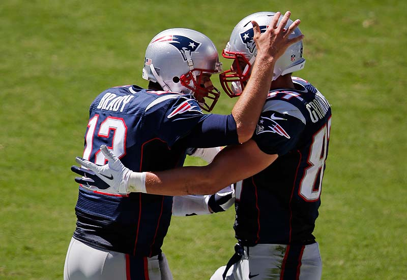 Patriots quarterback Tom Brady, left, celebrates with tight end Rob Gronkowski after throwing a 2-yard touchdown pass in the second quarter Sunday in Nashville, Tenn. The Patriots won, 34-13.