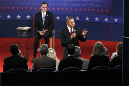 Republican presidential candidate former Massachusetts Gov. Mitt Romney, left, listens as President Barack Obama answers a question from a member of the audience during the second presidential debate at Hofstra University, Tuesday, Oct. 16, 2012 Hempstead, N.Y. (AP Photo/Mary Altaffer)