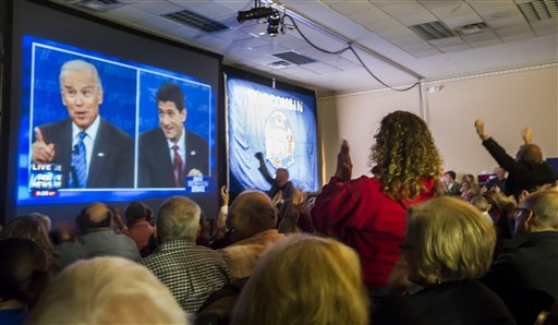 Supporters of Republican vice presidential nominee Rep. Paul Ryan, of Wisconsin, gather at the Holiday Inn Express in Janesville, Wis. to watch his debate with Vice President Joe Biden on Thursday, Oct. 11, 2012. (AP Photo/The Janesville Gazette, Mark Kauzlarich) Vice Presidential Debate;Janesville
