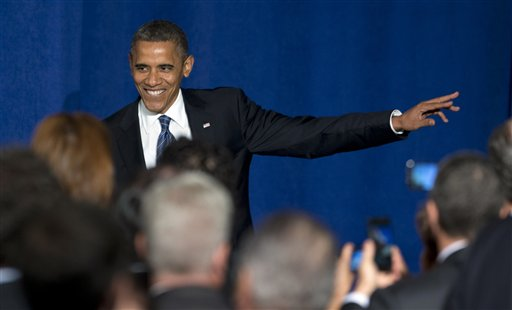 In this Oct. 11, 2012, file photo, President Barack Obama arrives at a campaign fundraiser at the JW Marriott Marquis Miami. (AP Photo/Carolyn Kaster, File)