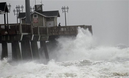 Large waves generated by Hurricane Sandy crash into Jeanette's Pier in Nags Head, N.C., on Saturday, Oct. 27, 2012 as the storm moves up the East Coast. Hurricane Sandy, upgraded again Saturday just hours after forecasters said it had weakened to a tropical storm, was expected to make landfall early Tuesday near the Delaware coast, then hit two winter weather systems as it moves inland, creating a hybrid monster storm.