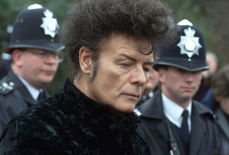 In this 2000 file photo, British performer Gary Glitter, attends a news conference in London.