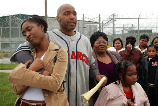 In this April 16, 2003, file photo, Terry Harrington, center, stands with his daughter Nicole Brown, left, his mother, Josephine James, right, and family and friends outside the Clarinda Correctional Facility in Clarinda, Iowa, after Gov. Tom Vilsack signed his reprieve. In a trial that starts this week, Harrington and Curtis McGhee, wrongfully convicted in the 1977 murder of a retired Iowa police officer, are suing the city of Council Bluffs, Iowa, and police officers they blame for forcing them to spend their adult lives in a state prison.