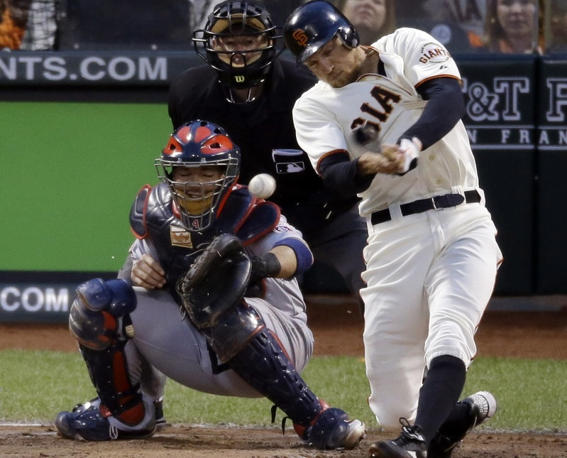San Francisco Giants' Hunter Pence hits a three-run double during the third inning of Game 7 of the National League championship series against the St. Louis Cardinals on Monday in San Francisco.