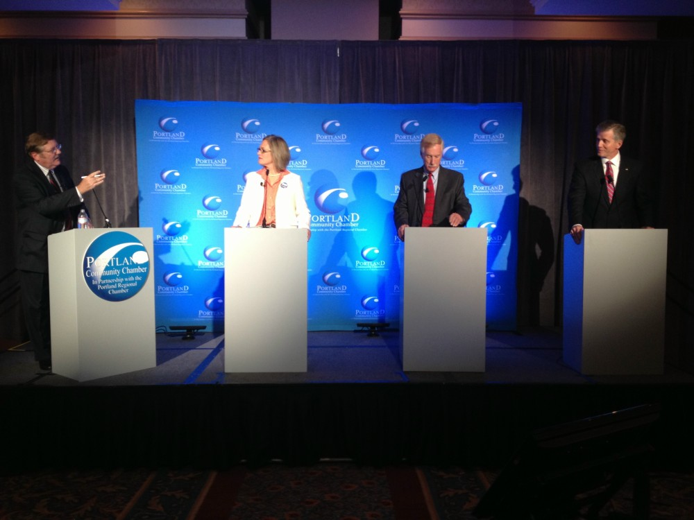 Left to right, Chris Hall, moderator, and U.S. Senate candidates Cynthia Dill, Angus King and Charlie Summers appeared at the Eggs and Issues Debate hosted by the Portland Regional Chamber. Gordon Chibroski/Staff Photographer
