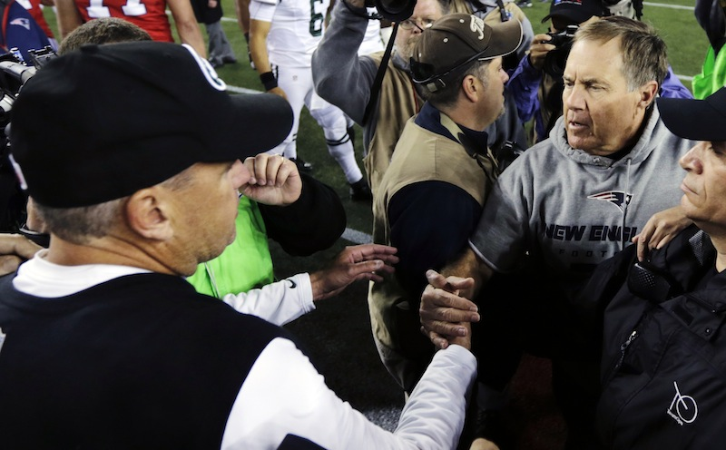 New England Patriots head coach Bill Belichick, right, shakes hands with New York Jets head coach Rex Ryan, left, after the Patriots' 29-26 overtime win in an NFL football game in Foxborough, Mass., Sunday, Oct. 21, 2012. (AP Photo/Charles Krupa) NFLACTION12; Gillette Stadium