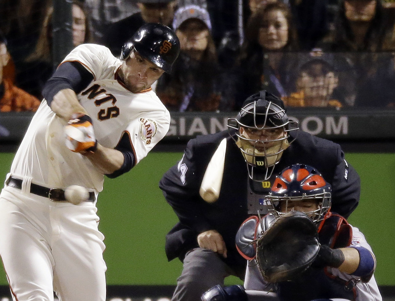 The Giants' Brandon Belt breaks his bat as he hits a single in the eighth inning of Game 6 of the National League championship series against the St. Louis Cardinals Sunday in San Francisco. The Giants won, 6-1.